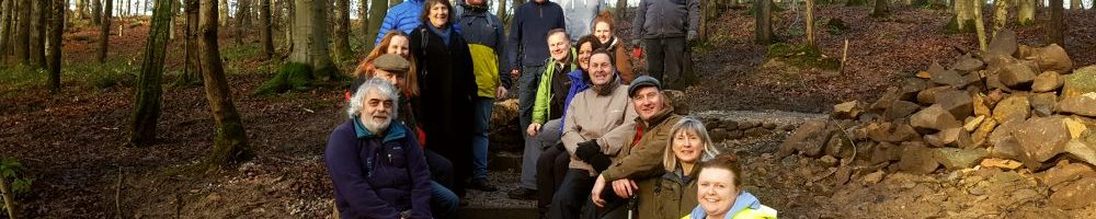 Skipton volunteers sat on new steps in the woods