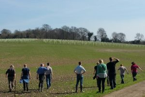 Volunteers looking at newly planted trees at Langley Vale Wood