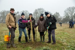 Volunteers planting the orchard at Langley Vale Wood