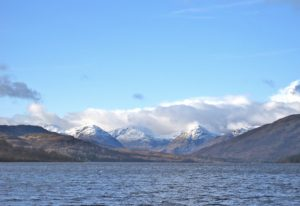 View to the snow capped Arrochar Alps from Loch Katrine