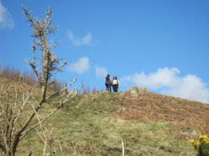 Placing a marker post on the hillside